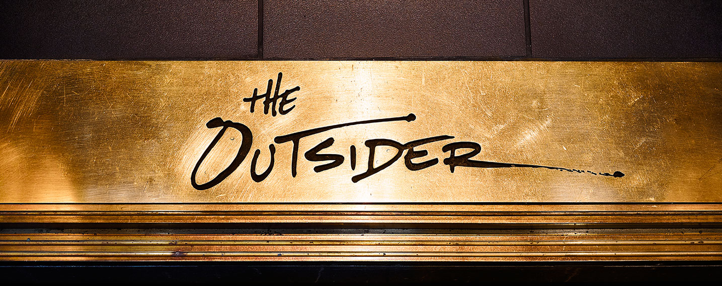 The Outsider Signage